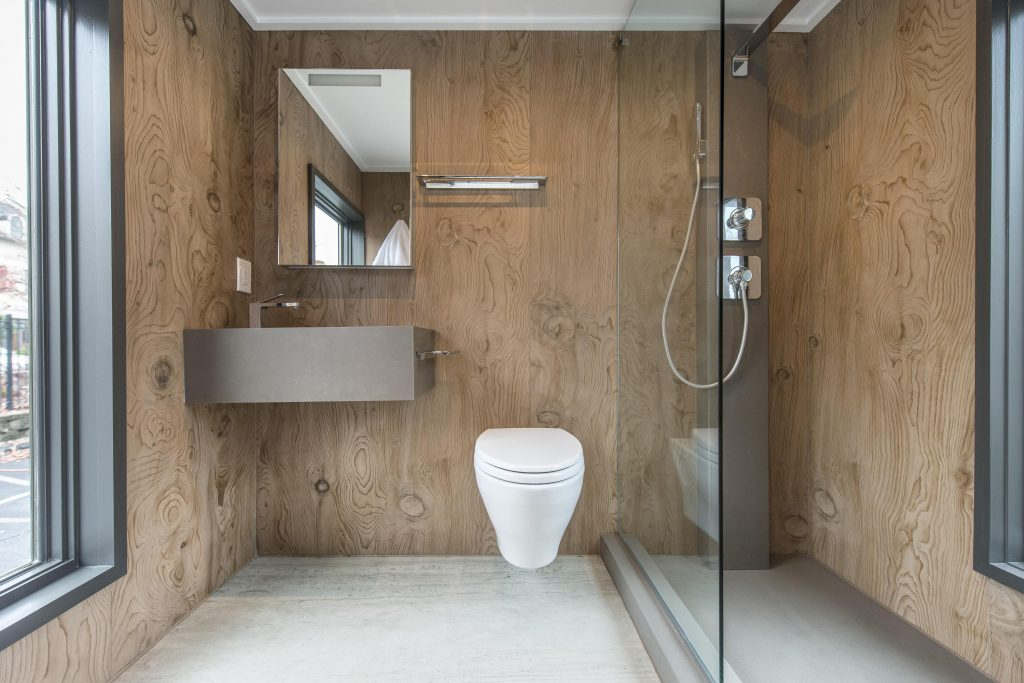 When designing a small space like a bathroom, thoughtfully selected wall or shower surfacing can make a huge difference. Consider unexpected textures, designs and materials such as Neolith sintered stone in the Lebanese cedar-inspired La Boheme design, pictured here.